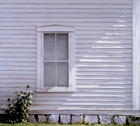 SIMPLE GIFTS by Carroll Jones III Pale purple clapboard side of home with window and weeds.  Diagonal shading