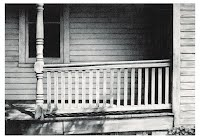 SOUTH JERSEY PORCH by Carroll Jones III window, porch, and railing of old white house partially shaded/sunny